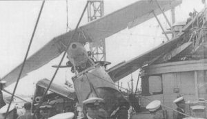 "HMAS ""Australia"" - hoisting Accident Seagull Mk 5 (A2-1) 26 March 1936. S2 4"" gun claims another victim! (C.P.O. Lionel Locke - Chief Bosn's Mate; Bos'n Elley (?); Sub-Lieut W.B.M. Marks.)"