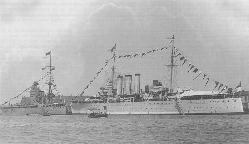 HMAS Canberra in happier times – shortly after commissioning in UK and before sailing for Australia, she was present during a visit by King George V to the Fleet at Portsmouth. Seen here manning ship in preparation to cheering the King, passing in his steam barge from the Flagship, Home Fleet, the new battleship HMS Nelson.