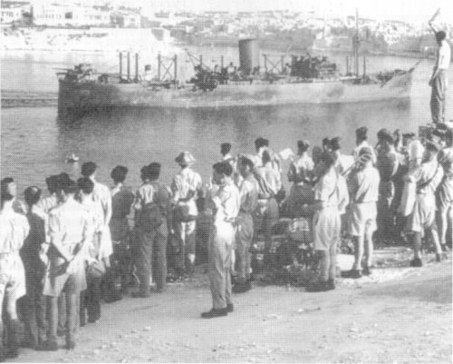Army personnel watch the SS Melbourne Star enter Grand Harbour, Valletta
