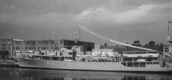 Flying a very long paying-off pendant, HMS Woodbridge Haven prepares to leave HM Naval Base Singapore on being relieved as Headquarters Ship of the Inshore Flotilla by HMS Manxman late 1963.