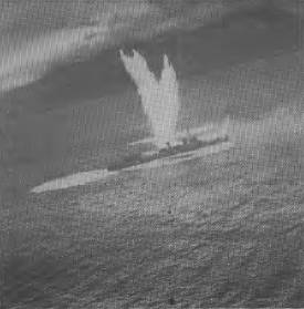 A Japanese destroyer stopped and sinking after three near misses by an Australian bomber during the Battle of the Bismarck Sea. This graphic shot is believed to have been taken by the famed Damien Parer.