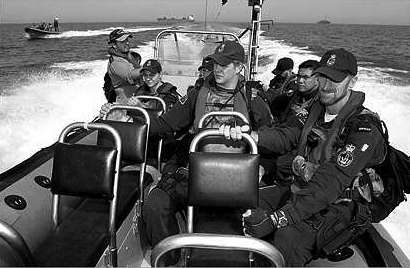 Navy RHIB (Rigid Hull Inflatable Boat) and boarding party in the Arabian Gulf (Image: Defence PR Photographic Collection)