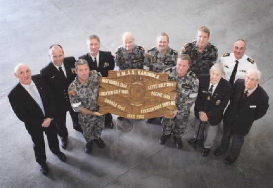 Former Commanding Officer of HMAS Kanimbla (II) in 2001-2003 (Capt David McCourt, OAM, DSM, RANR - Far left) and Mr Keith Bray and Mr Don Sykes from HMAS Kanimbla (I) join with Cmdr Tim Byles (Current CO of Kanimbla - second from left) for the HMAS Kanimbla Battle Honour Board Re-Dedication Ceremony. Joining them were members of Kanimbla's current crew who also served onboard on 2001-2003. Kanimbla was recently was recently awarded new honours for Borneo 1945, Persian Gulf 2001-2003, and Iraq 2003.