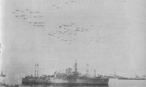 The grand flypast of the Allied Air Forces. The vessel in the foreground is a US Command Ship.