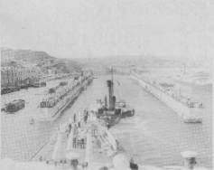 During her first run to the Mediterranean AUSTRALIA was docked in the large Admiralty Floating Dock in Malta. She is seen here entering the flooded down dock. June 1935.