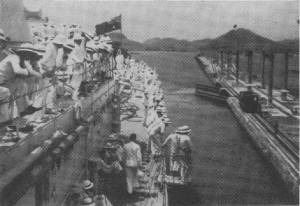 "Crossing from the Pacific to the Atlantic was made through the Panama Canal. Here we see ""AUSTRALIA"" entering the Gatun Locks, with the crew wearing the old standard sun helmet. 4.3.35."
