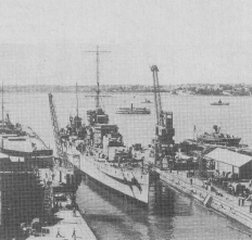"""A WW2 shot of the light cruiser """"LEANDER"""" entering the Calliope Dock. (Photo RNZM)"""