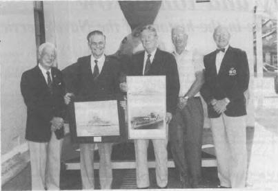 Mr Birrell, Mr Lind, Captain L.M. Hinchliffe, Mr Date, Mr Des Hagan accepting the memorabilia from the the HMAS Canberra/Shropshire Association of N.S.W