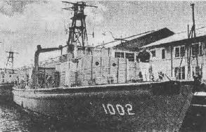 Denis Geary aboard ex.minesweeper Porpoise.