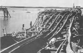 The twisted remains of the main wharf at Darwin after the Japanese air raid on 19 February, 1942.