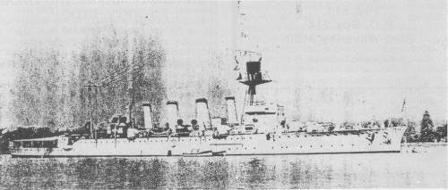HMAS ADELAIDE, mid 1920s. Two 6-inch guns are sited forward of the bridge, one on each beam; two searchlights amidships and abaft the fourth funnel; a wireless cabin is sited between the fore and second funnels and the control top and director tower are painted black.