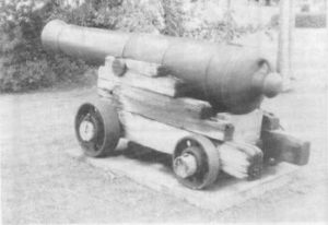 "A muzzle loading cannon, manufactured in 1803, and sent to Cooktown in 1883 ""…with three cannon balls, one officer and two rifles"", in response to the perceived Russian threat in the south-west Pacific in the late 1870s. Photographed beside the Endeavour River, in Central Cooktown, 1996."