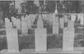 Graves in the Baghdad North Gate Cemetery. The grave in the centre is that of Petty Officer Gilbert flanked by two sailors from HM Submarine E7.