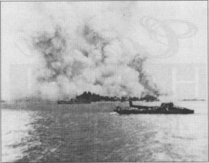 USS Mount Hood explodes with 3800 tons of ammunition
