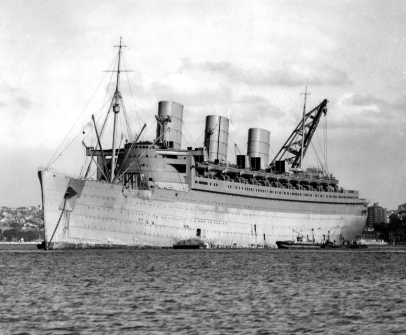 Queen Mary at anchor in Sydney Harbour in 1940 during her conversion to a troopship