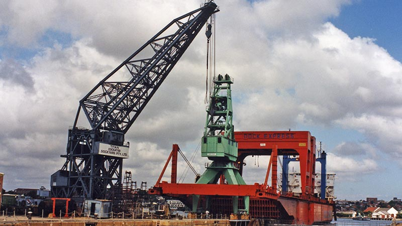 The 30-tonne portal crane being loaded on to a heavy-lift ship for transport to Western Australia
