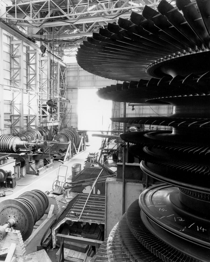 A wide range of turbine rotors under repair in the Turbine Shop on Cockatoo Island in the 1980s